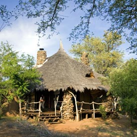 Rustic stone and thatched chalets at Kariega