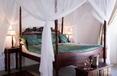 Cool, Colonial-style bedroom at Ibo Island, Mozambique