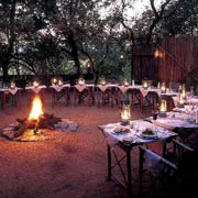 Dine around the fire in the open-air boma